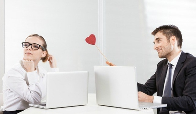 how to tell if a coworker is attracted to you