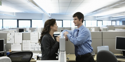 18 Signs He's Flirting at Work for Sure - EnkiRelations
